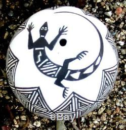 Acoma seed pot by Lucario with black on white geometrics and lizard around hole