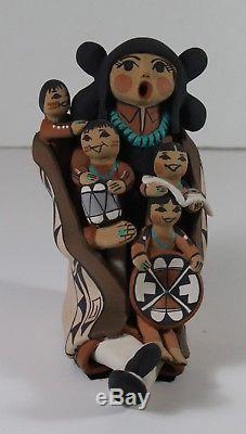 Native American Jemez Pueblo Storyteller, 4 children by Carol Lucero Gachupin