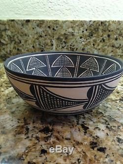 Native American Pottery. Shallow Bowl rosy bottom painted black