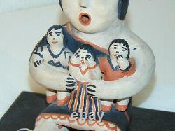 Storyteller Pottery, by Seferina Ortiz. Cochiti Pueblo NM. Signed